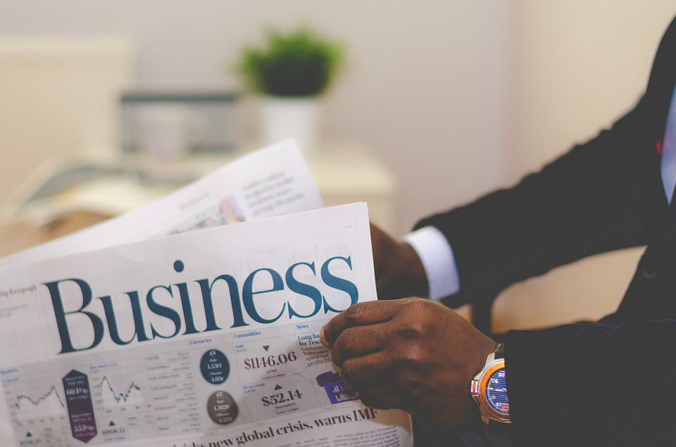 man reading business newsletter